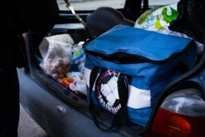 Les sacs de nourriture sont aux couleurs du CUP Solidarité